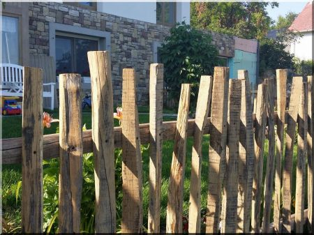Antic fence from aged wood