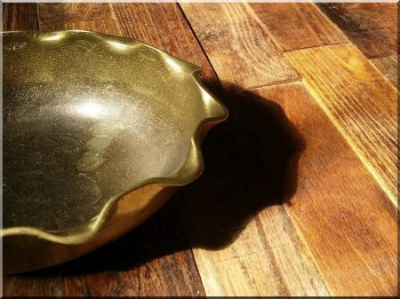 Curled brass serving bowl